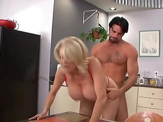 Sexy busty milf cleaning the kitchen nude
